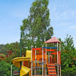 A colorful public playground in a garden — Stock Photo #6640714
