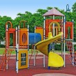 A colorful public playground in a garden — Stock Photo #6640876