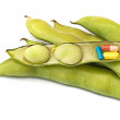 Royalty-Free Stock Photo: Pills in green beans as a symbol of green medicine