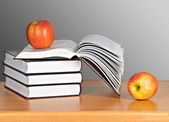 Apple on pile of books — Stock Photo