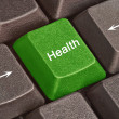 Stock Photo: Keyboard with key for health