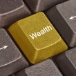 Keyboard with key for wealth — Stock Photo
