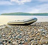 Boat on lake beach — Stock Photo