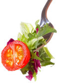 Fork with tomato and greens — Stock Photo