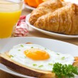 Breakfast with fried egg, juice and croissant — Stock Photo #5537216