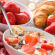 Breakfast with cereals in bowl with strawberries — Stock Photo