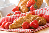 Croissants with strawberry — Stock Photo