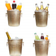 Set with different bottles in ice bucket — Stock Photo