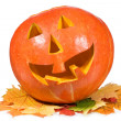 Royalty-Free Stock Photo: Halloween pumpkin with autumn leaves