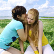 Girl whisper secret to girl-friend — Stock Photo #6284844