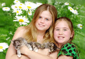 Portrait girls with cats — Stock Photo