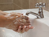 Hands washing in basin — Stock Photo
