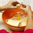 Breaking an egg into bowl for cooking — Stock Photo