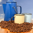 Coffee kettle cups and beans with blue background - Stock Photo