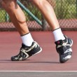 Tennis player legs and feet on court - Stock Photo
