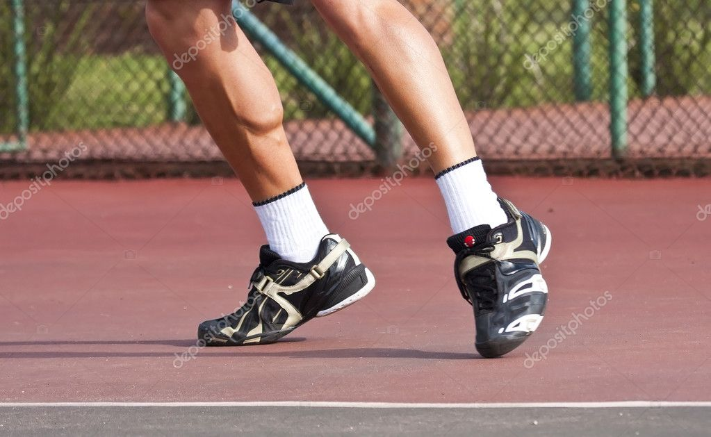 Tennis player legs and feet on court stock photo for Sport court cost per square foot