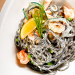 Seafood black spaghetti - Stock Photo