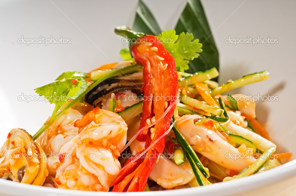 Fresh seafood thai style salad with glass noodles on a bowl close up  Stock Photo #5581036