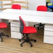 Office desks and red chairs cubicle set — Stock Photo #6365859