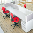 Office desks and red chairs cubicle set — Stock Photo #6365877