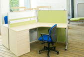Office desks and blue chairs cubicle set — Stock Photo