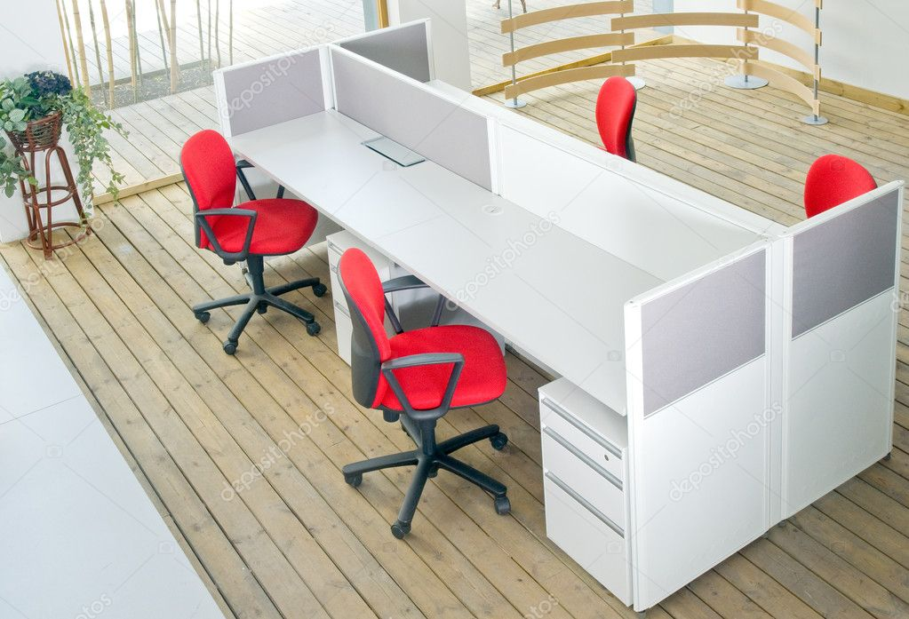 Office desks and red chairs cubicle set view from top over wood flooring  — Stock Photo #6365877