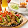 Original fajita sizzling hot on iron plate — Stock Photo #6499370