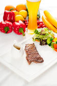 Juicy BBQ grilled rib eye ,ribeye steak and vegetables — Stock Photo