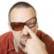 Man in red t shirt with fancy broken glasses — Stock Photo #5392130