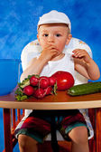 Short boy with vegetables — Стоковое фото