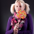 Woman holding lollypop — Stockfoto