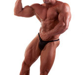 Bodybuilder flexing his muscles — Stock Photo