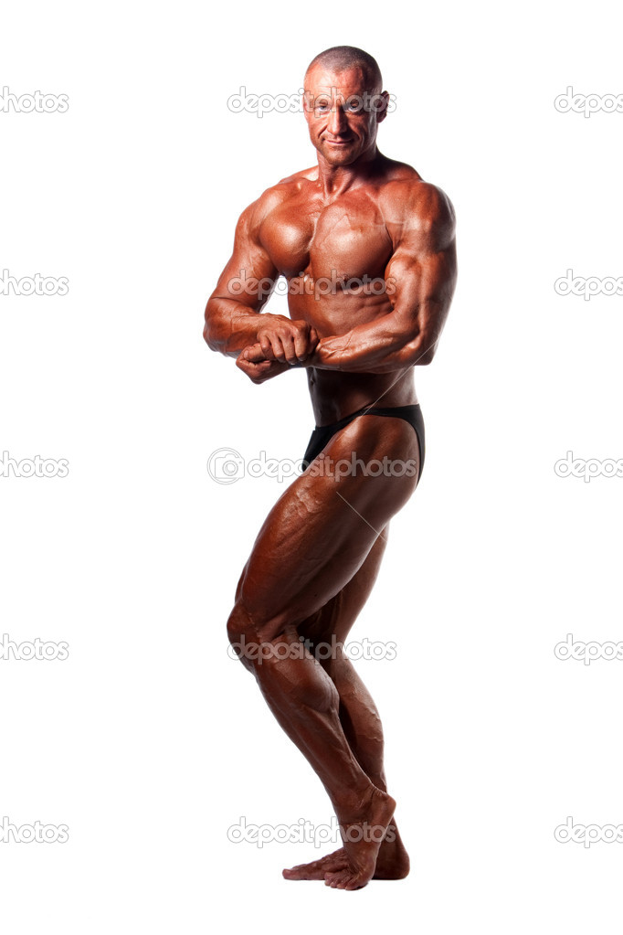 Bodybuilder posing over white background  Stock Photo #6372294