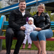 Mom, dad, baby, bench — Stock Photo