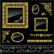 Set of golden frames and design elements — Stock Vector