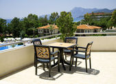 Table and chairs in tourist resort — Stock Photo