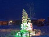 Icy figure in the nightly illuminating — Stock Photo