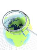 放大镜和地球球体 — 图库照片