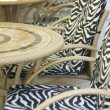 Round tables and chairs - Stock Photo