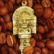 Coffee beans with golden Indian god — Stockfoto
