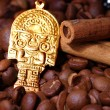 Closeup of coffee beans with golden Indian god - Zdjcie stockowe
