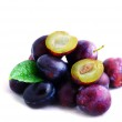 Plums. Fresh ripe washed plums over white background — Stock Photo #6523760