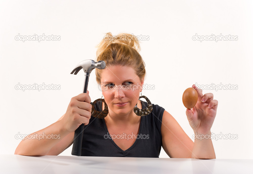 Blond planning some mischief with an egg — Stock Photo #6414020