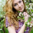 Red-headed woman under cherry tree — 图库照片