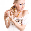 Woman unplaiting her hair — Foto Stock