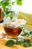 Tea with dog-rose blossom — Stock Photo
