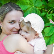 Mother and baby girl hugging — Stock Photo #5909540