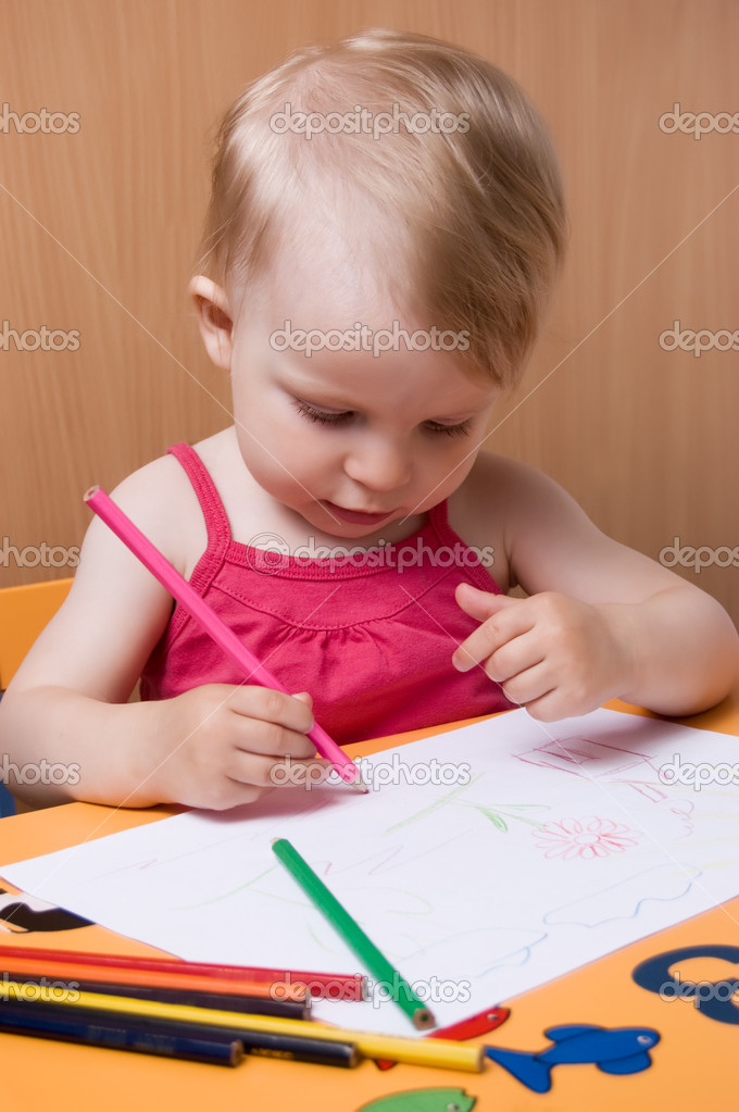 Baby girl coloring with pencils at table  Stock Photo #5909533