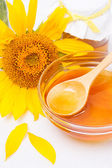 Honey and sunflower — Stock Photo