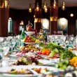 Celebratory buffet table at restaurant - Stock Photo